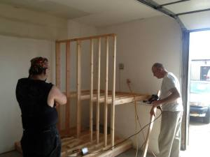 Terre and Steve work on the storage rack